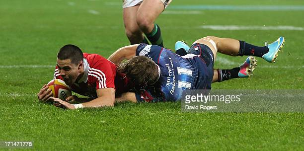 Sean Maitland of the Lions dives over for the Lions second try despite the attention of Lachlan Mitchell during the International Tour Match between...