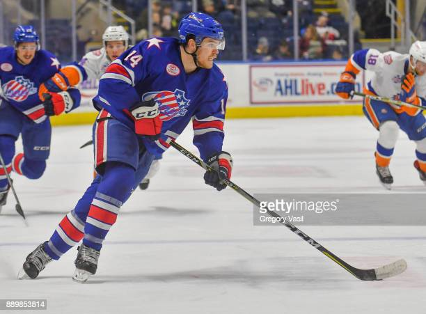 Sean Malone of the Rochester Americans carries the puck up ice during a game against the Bridgeport Sound Tigers at the Webster Bank Arena on...