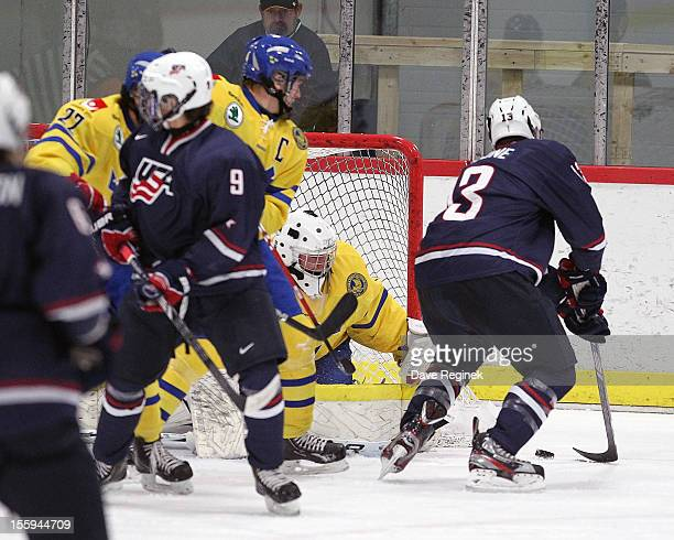 Sean Malone of the USA scores a first period goal against Ebbe Sionas of Sweden during the U-18 Four Nations Cup on November 9, 2012 at the Ann Arbor...
