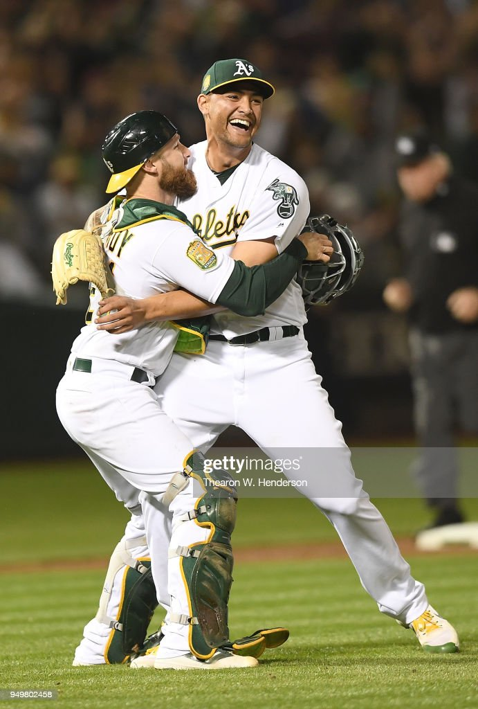 Sean Manaea #55 and Jonathan Lucroy #21 of the Oakland Athletics celebrates after Manaea pitched a no-hitter against the Boston Red Sox at the Oakland Alameda Coliseum on April 21, 2018 in Oakland, California. The Athletics won the game 3-0.