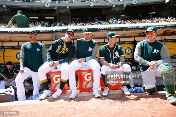 Sean Manaea Daniel Mengden Jesse Hahn Chad Pinder and Josh Phegley of the Oakland Athletics relax in the dugout during the game against the Seattle...