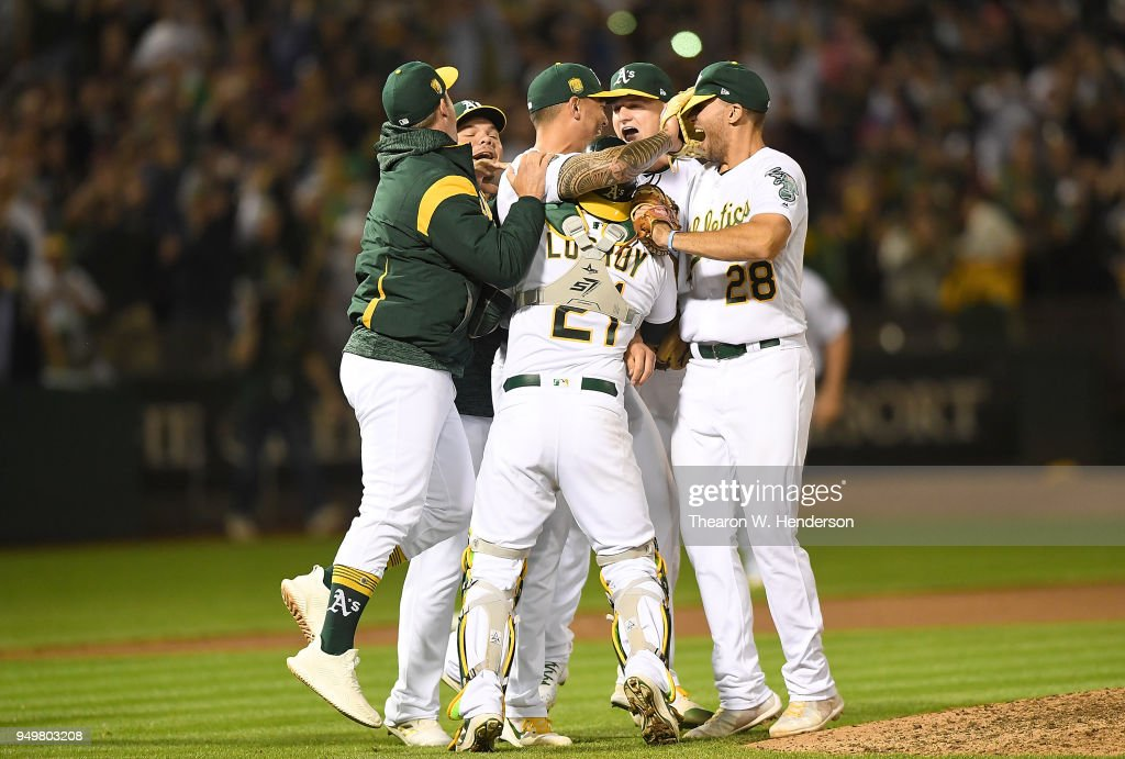 Sean Manaea #55 of the Oakland Athletics (C) celebrates with his teammates after he pitched a no-hitter against the Boston Red Sox at the Oakland Alameda Coliseum on April 21, 2018 in Oakland, California. The Athletics won the game 3-0.