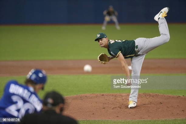 Sean Manaea of the Oakland Athletics delivers a pitch to Josh Donaldson of the Toronto Blue Jays in the first inning during MLB game action at Rogers...