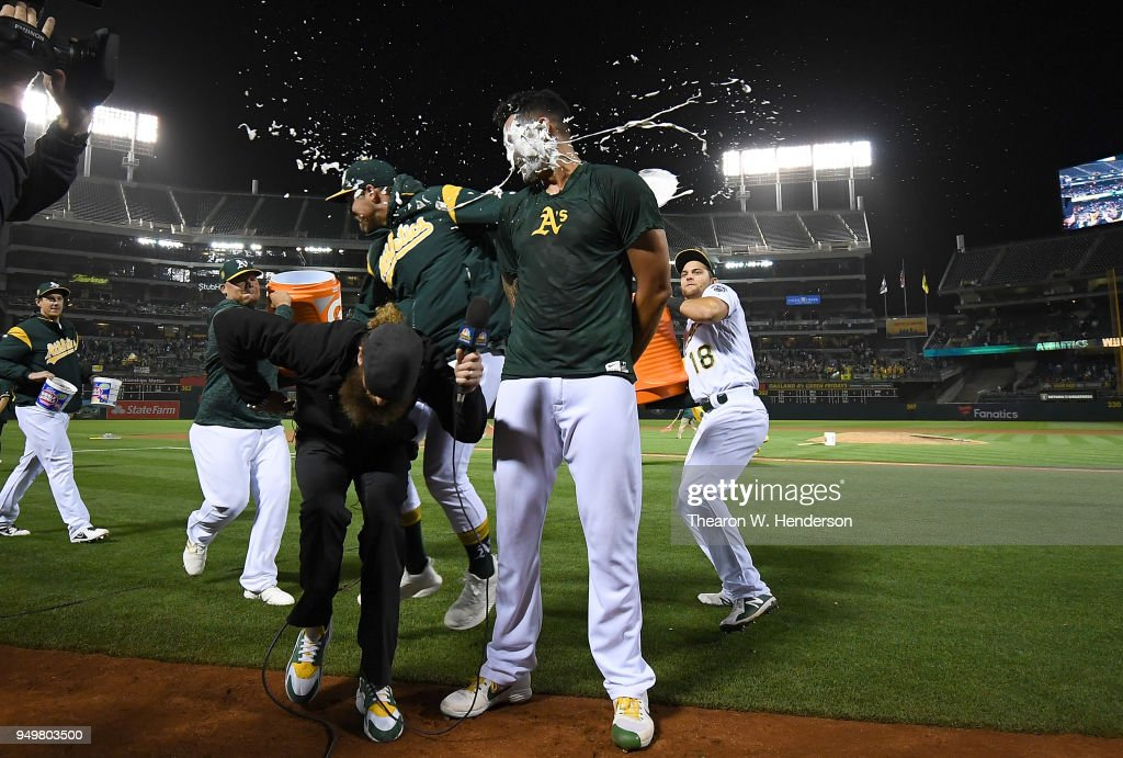 Sean Manaea #55 of the Oakland Athletics gets a pie in the face by a teammate after Manaea threw a no-hitter against the Boston Red Sox at the Oakland Alameda Coliseum on April 21, 2018 in Oakland, California. Dallas Braden, the last Athletic to throw a perfect game no-hitter, ducks out of the way of the pie.