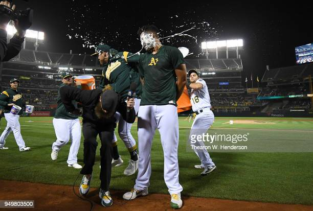 Sean Manaea of the Oakland Athletics gets a pie in the face by a teammate after Manaea threw a nohitter against the Boston Red Sox at the Oakland...