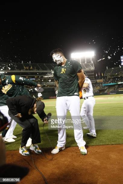 Sean Manaea of the Oakland Athletics gets pied on the field after pitching a nohitter following the game against the Boston Red Sox at the Oakland...