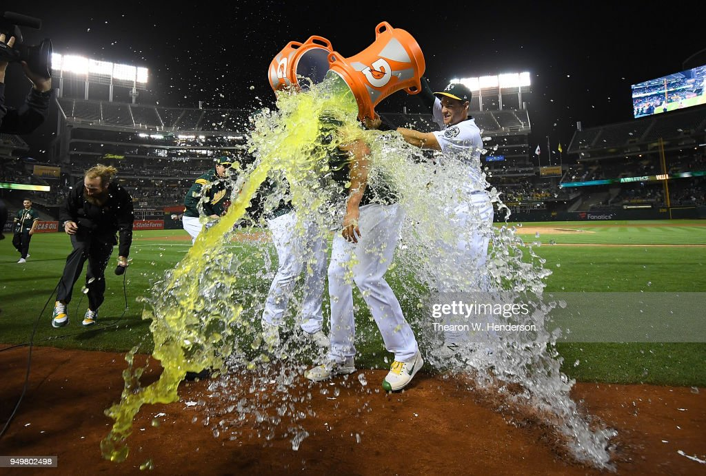 Sean Manaea #55 of the Oakland Athletics gets showered with gatorade and water by teammates after he threw a no-hitter against the Boston Red Sox at the Oakland Alameda Coliseum on April 21, 2018 in Oakland, California. The Athletics won the game 3-0.