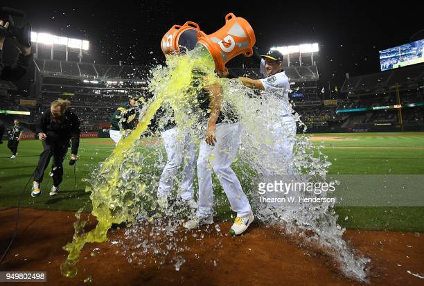 Sean Manaea of the Oakland Athletics gets showered with gatorade and water by teammates after he threw a nohitter against the Boston Red Sox at the...