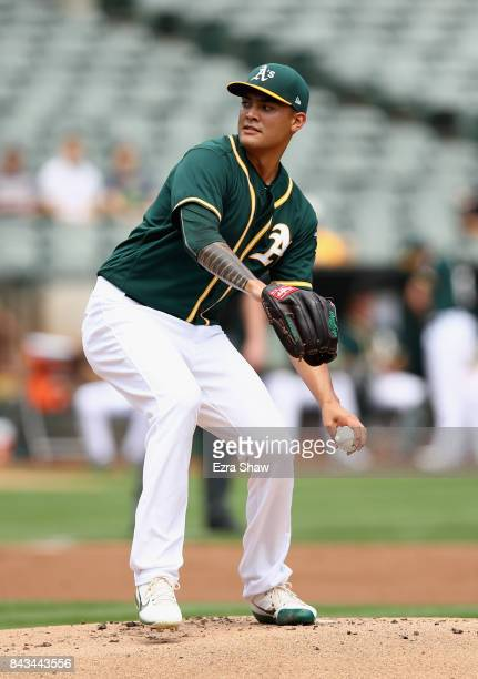 Sean Manaea of the Oakland Athletics pitches against Los Angeles Angels in the first inning at Oakland Alameda Coliseum on September 6 2017 in...