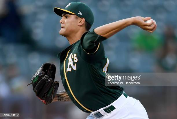 Sean Manaea of the Oakland Athletics pitches against the Houston Astros in the top of the first inning at Oakland Alameda Coliseum on June 21 2017 in...
