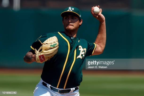 Khris Davis of the Oakland Athletics rounds the bases after hitting a home run against the Houston Astros during the first inning at the Oakland...