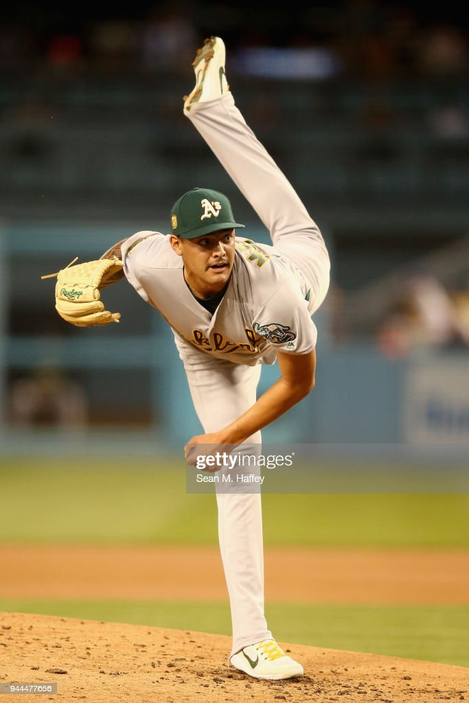 Sean Manaea #55 of the Oakland Athletics pitches during the first inning of a game against the Los Angeles Dodgers at Dodger Stadium on April 10, 2018 in Los Angeles, California.