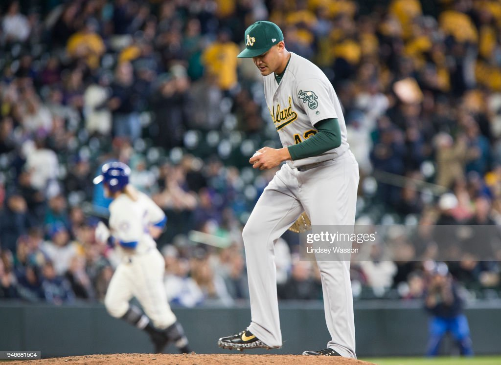 Sean Manaea #55 of the Oakland Athletics reacts after giving up a home run to Taylor Motter #21 of the Seattle Mariners in the fifth inning at Safeco Field on April 15, 2018 in Seattle, Washington. All players are wearing #42 in honor of Jackie Robinson Day.
