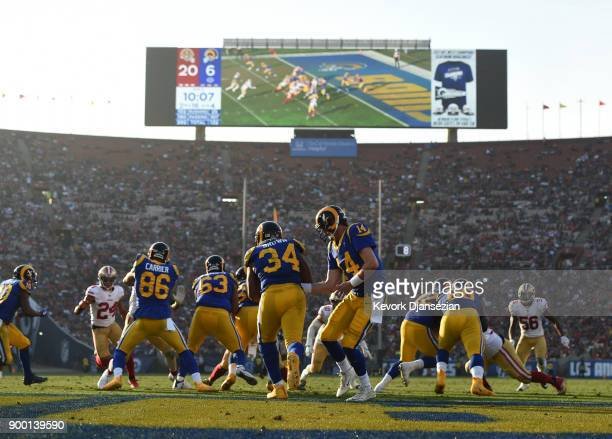 Sean Mannion of the Los Angeles Rams hands off the ball to running back Malcolm Brown of the Los Angeles Rams during the third quarter against San...