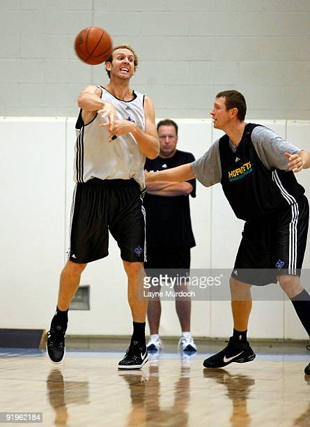 Sean Marks of the New Orleans Hornets passes the ball against Darius Songaila in training camp on October 16 2009 at the Alario Center in Westego...