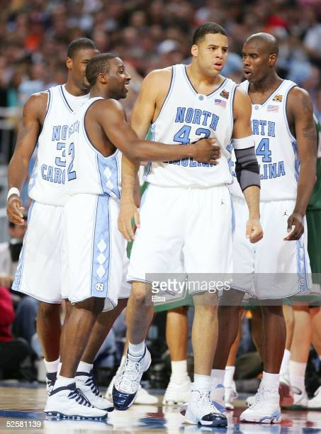 Sean May and Raymond Felton of the North Carolina Tar Heels react after a play against the Michigan State Spartans in the second half during the NCAA...