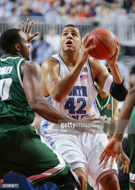 Sean May of the North Carolina Tar Heels looks for an open shot around the Michigan State Spartans during the first half of the NCAA Men's Final Four...