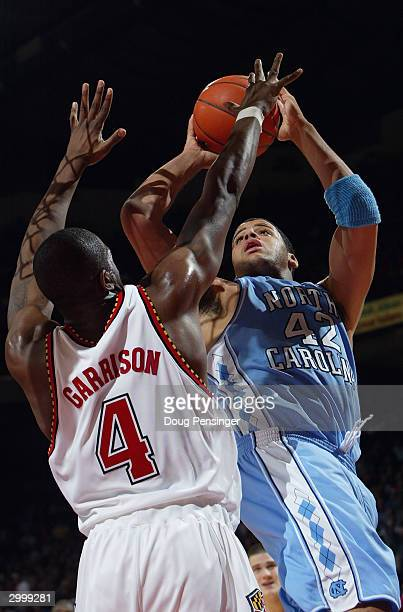 Sean May of the North Carolina Tar Heels shoots over Travis Garrison of the Maryland Terrapins during the game on January 14 2004 at the Comcast...