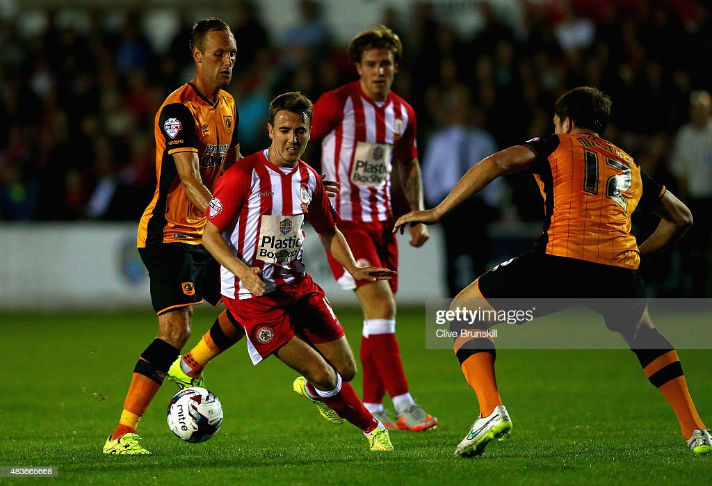 Sean McConville of Accrington Stanley attempts to move past Harry Maguire of Hull City during the Capital One Cup First Round match between Accrington Stanley and Hull City at Wham Stadium on August 11, 2015 in Accrington, England.