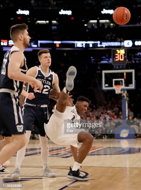 Sean McDermott of the Butler Bulldogs is called for a flagrant foul in the second half as he shoves Kalif Young of the Providence Friars during the...