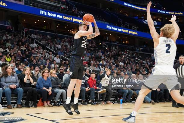 Sean McDermott of the Butler Bulldogs takes a jump shot over Mac McClung of the Georgetown Hoyas in the second half during a college basketball game...