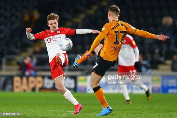 Sean McLoughlin of Hull City chalenges Luke Thomas of Barnsley FC during the Sky Bet Championship match between Hull City and Barnsley at KCOM...