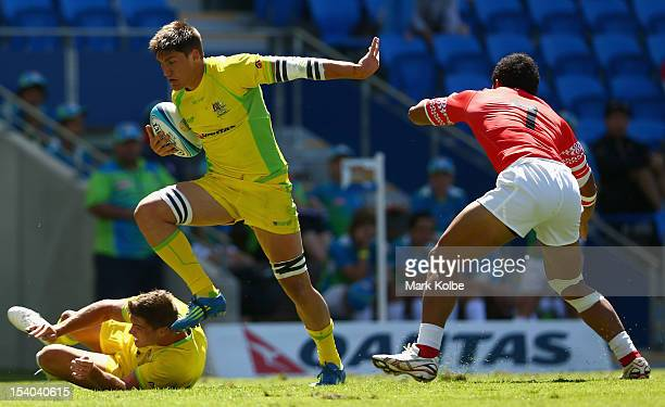 Sean McMahon of Australia breaks on his way to scoring a try during the match between Australia and Tonga on day one of the 2012 Gold Coast Sevens at...