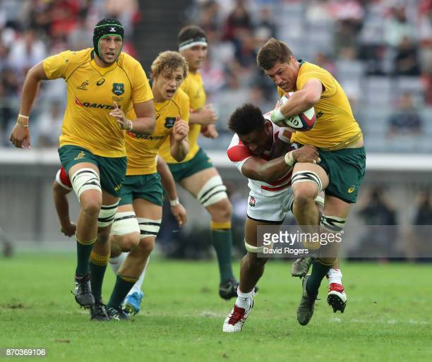 Sean McMahon of Australia breaks with the ball during the rugby union international match between Japan and Australia Wallabies at Nissan Stadium on...