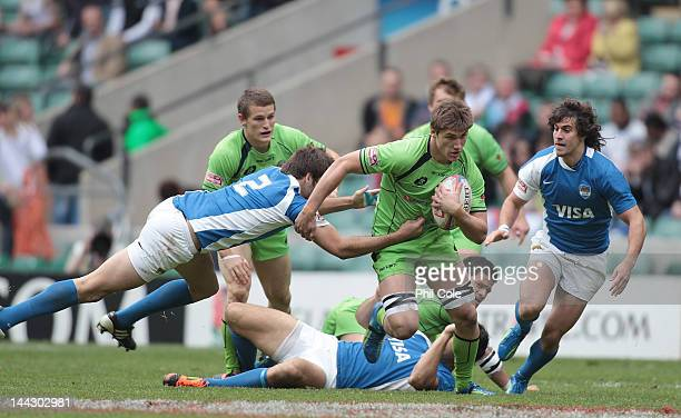 Sean McMahon of Australia gets tackled by Ignacio Pasman of Argentina during the quarter finals of the IRB Men's Sevens Challenge Cup at Twickenham...