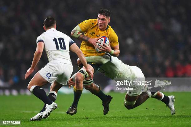 Sean McMahon of Australia is tackled by Courtney Lawes of England during the Old Mutual Wealth Series match between England and Australia at...