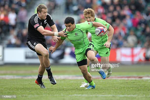 Sean McMahon of Australia is tackled by Tim Mikkleson of New Zealand during the Australia and New Zealand match during day two of the IRB Glasgow...