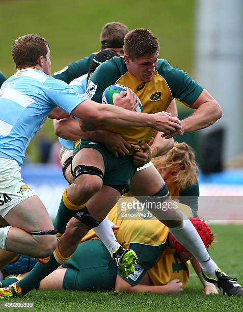 Sean McMahon of Australia is tackled during the 2014 Junior World Championships match between Argentina and Australia at ECOLight Stadium Pukekohe on...