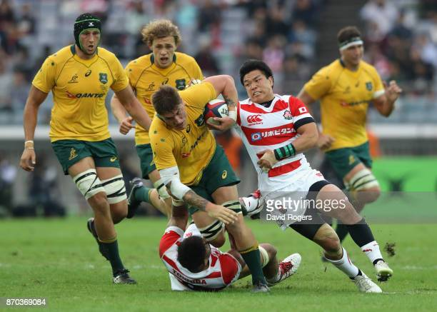 Sean McMahon of Australia is tackled during the rugby union international match between Japan and Australia Wallabies at Nissan Stadium on November 4...