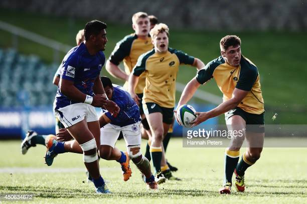 Sean McMahon of Australia looks to pass the ball out during the 2014 Junior World Championship 5th Place Semi Final match between Australia and Samoa...