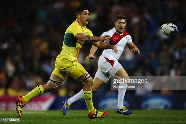 Sean McMahon of Australia passes the ball out during the Rugby Sevens match between Australia and England at Ibrox Stadium during day three of the...