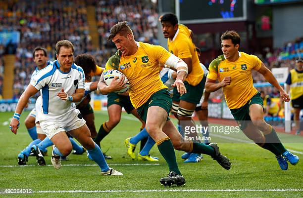Sean McMahon of Australia runs in to score his side's first try during the 2015 Rugby World Cup Pool A match between Australia and Uruguay at Villa...