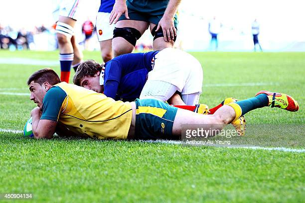 Sean McMahon of Australia scores a try against Baptiste Serin of France during the 2014 Junior World Championship 5th Place PlayOff match between...