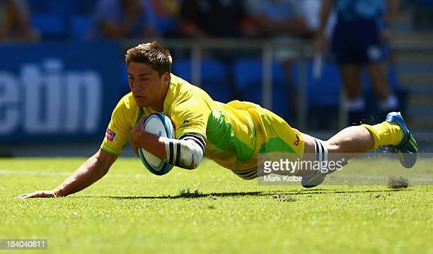 Sean McMahon of Australia scores a try during the match between Australia and Tonga on day one of the 2012 Gold Coast Sevens at Skilled Park on...