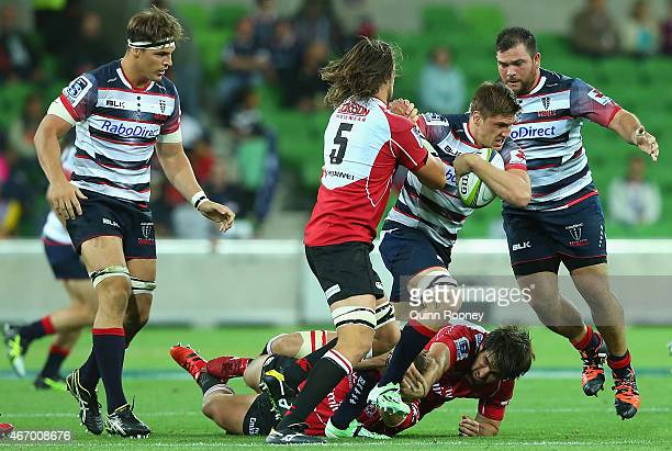 Sean McMahon of the Rebels is tackled by Franco Mostert of the Lions during the round six Super Rugby match between the Rebels and the Lions at AAMI...