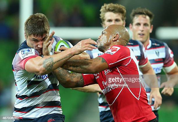 Sean McMahon of the Rebels is tackled by Lionel Mapoe of the Lions during the round six Super Rugby match between the Rebels and the Lions at AAMI...