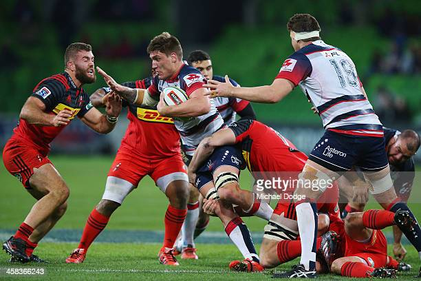 Sean McMahon of the Rebels is tackled during the round 15 Super Rugby match between the Rebels and the Stormers at AAMI Park on July 2 2016 in...