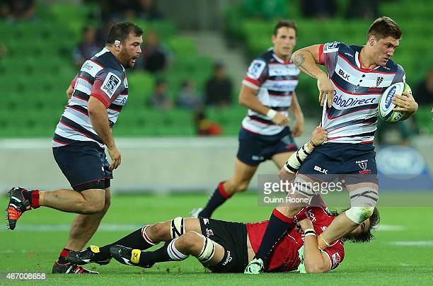 Sean McMahon of the Rebels is tackled during the round six Super Rugby match between the Rebels and the Lions at AAMI Park on March 20 2015 in...