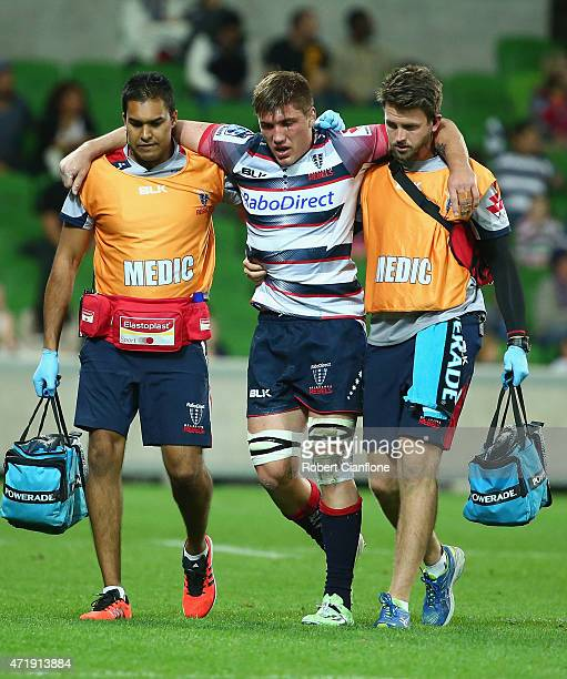 Sean McMahon of the Rebels leaves the field with an injury during the round 12 Super Rugby match between the Rebels and the Chiefs at AAMI Park on...