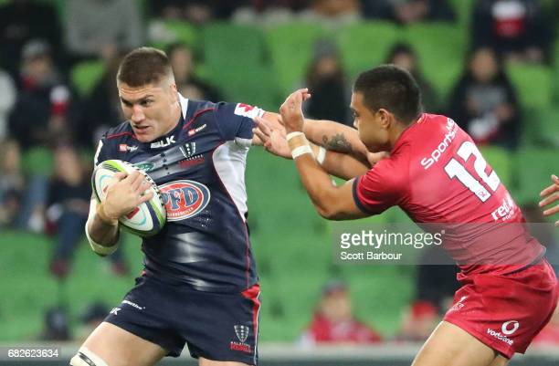 Sean McMahon of the Rebels runs with the ball during the round 12 Super Rugby match between the Melbourne Rebels and the Queensland Reds at AAMI Park...