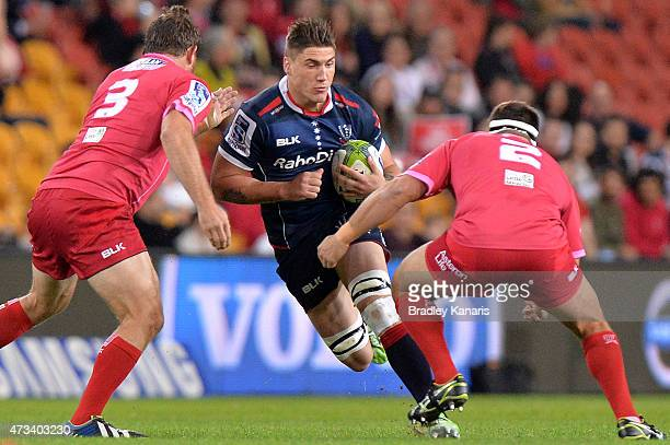 Sean McMahon of the Rebels takes on the defence during the round 14 Super Rugby match between the Queensland Reds and the Melbourne Rebels at Suncorp...