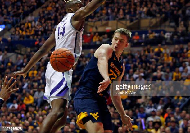 Sean McNeil of the West Virginia Mountaineers makes a pass against Makol Mawien of the Kansas State Wildcats at the WVU Coliseum on February 1 2020...