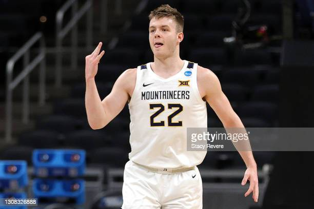 Sean McNeil of the West Virginia Mountaineers reacts after a three point basket against the Syracuse Orange in the second half of their second round...