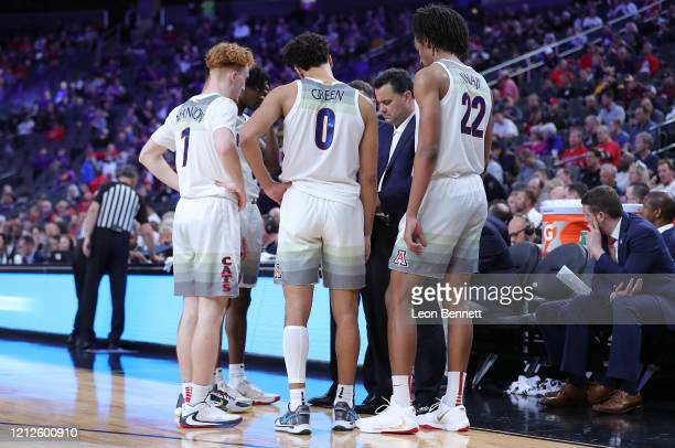 Sean Miller head coach of the Arizona Wildcats going over the game plan with his team Washington Huskies during the first round of the Pac-12...