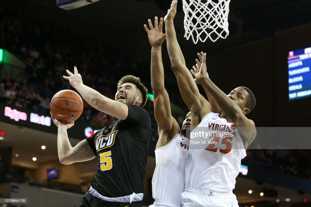747472e4a63 Sean Mobley of the VCU Rams attempts to shoot over Braxton Key and ...