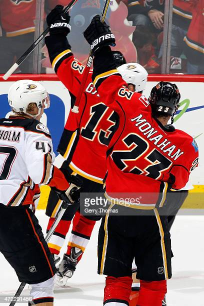 Sean Monahan and Johnny Gaudreau of the Calgary Flames celebrate a goal against the Anaheim Ducks at Scotiabank Saddledome for Game Three of the...